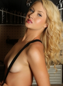 Ashlie Madison Keeps Her Perky Tits Covered By Just Her Suspenders In The Workshop - Picture 8